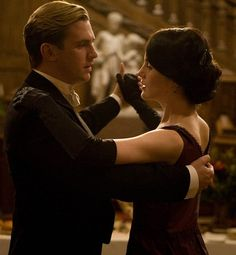 Mary and Matthew dancing...this scene was so sweet but so sad when Lavinia came down the stairs. :(