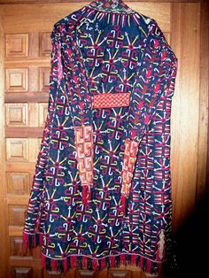 A major category of Turkmen embroidery is the chyrpy.  This is a mantle, approximately in the form of a coat with nonfunctional sleeves, worn by women on special occasions.  They were made in several background colors - black, red, green, white and yellow.  It is generally believed that the colors signal the age and/or marital status of the wearer, although I don't know how firm the evidence for this is.  They are embroidered in silk on silk backgrounds.