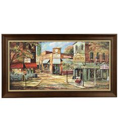 """Stroll down main street with a memorable art print from Ruane Manning's new collection tailored to the southern charm! The bright colors offset the simple scene that'll have all your guests talking. Find """"Village Shops"""" at Kirkland's for a warm addition to your wall decor."""