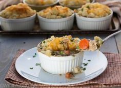 This amazing #glutenfree Potato Crusted Pot Pie recipe is topped with cheddar mashed potatoes and is stuffed with tender turkey, hearty vegetables, and savory gravy.