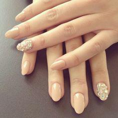 oval nude nails with silver glitter