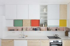 A Dries Otten kitchen - a modern interpretation of the bright bold colour-blocking midcentury kitchens.