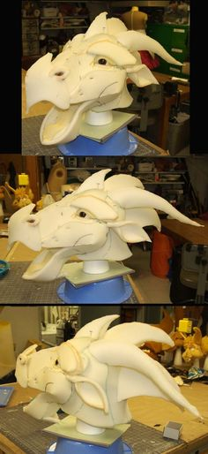 So for one of my theatre classes I'm making a large foam dragon head. This is the mock-up as I work out the pattern for the head. He is mounted on a hard-hat and his mouth will be made to move when...