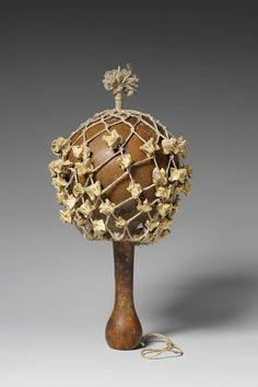 Africa | Musical instrument ~ Rattle from Benin | Late 19th century | Gourd, wood, fiber and bones.