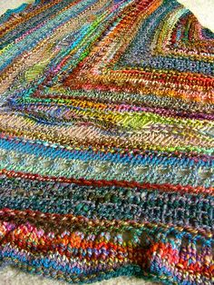 Colorful chevron-striped shawl.