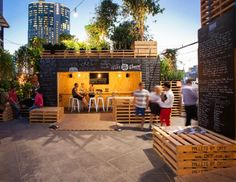 A vibrant urban coffee farm and cafe made of pallets and shipping containers temporarily inhabits downtown Melbourne for the city's 2013 Food and Wine Festival.
