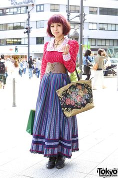 Grimoire-loving girl wearing a maxi-skirt and corset belt on the street in Harajuku.    Oh my goodness. This chick looks rad as! The hair, belt, shirt, skirt and even shoes are absolutely perfect. Perfect Harajuku fashion right there.