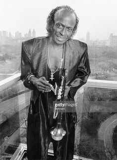 Jazz trumpeter Miles Davis stands on the balcony of his apartment overlooking Central Park.