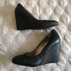 BCBG black leather wedges round toe size 10 Worn twice. Size 10. BCBG black leather wedges approx 4 inches. Round toe is very comfortable. Features matte silver BCBG medallion at back of shoes. Classic year round style. 15% off bundle of 2+ items  BCBG Shoes Wedges