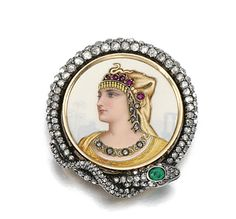 Gold, gem set and diamond brooch/pendant, Golay Fils, last quarter of the 19th century. To a central painted enamel image depicting Cleopatra wearing ruby and diamond jewels, framed by a coiled serpent the head inset with an oval emerald to graduated rose diamonds, signed A.Golay L. & Fils, Geneve, hinged bail