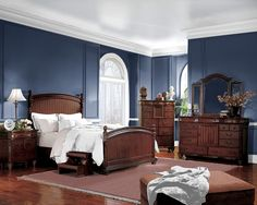 Navy bedroom (look how great the brown furniture goes with the navy and white. could easily incorporate with the existing gray
