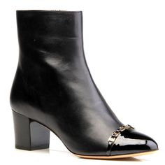 Classic ankle bootie with round toe and chain logo detail across the patent toe. $895