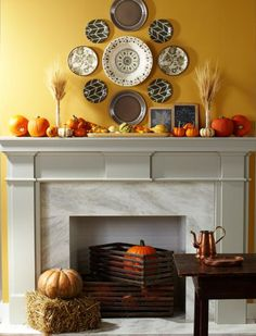 Create an harvest-inspired mantel for Thanksgiving with inexpensive melamine plates, wheat, gourds, pumpkins. Here's how: http://www.midwestliving.com/homes/seasonal-decorating/fall-decorating-1-mantel-3-ways/?page=5