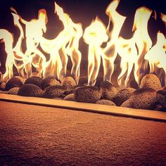 That rolled lava rock looks pretty great against the : What better way to eat your dinner. Fun functional and heat! Perfect for Western NY! Fire Table, How To Look Pretty, Lava, Making Out, Landscape Design, Backyard, Patio, Outdoor Living, Lion Sculpture