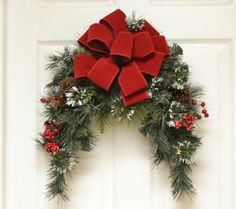 CR4840D - Arched #HolidaySwag with red bow, berries and pine cones.