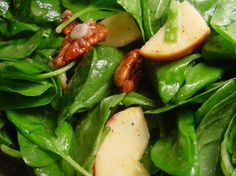 Spinach, apples, red onion And pecans in a sweet-tart dressing.  To make this salad extra special, I like to glaze the pecans by stirring them with 1 tablespoon sugar in a medium non-stick frying pan over medium heat, stirring constantly until sugar melts.  Pour them out on waxed paper and separate with your spoon while still warm.  If you do this, you dont need to toast the pecans.  It takes about 5 minutes or so for the sugar to melt.