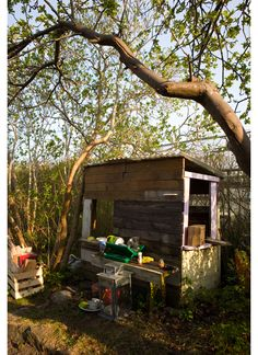 Rustic playhouse made from a produce stand.