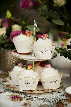 sweet little cupcakes with a rose on top!  all the beauty things...