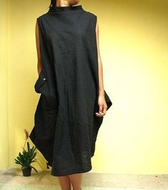Beautiful dress tulip shape.    Made of super elegant hand-woven cotton fabric. 2 layers weave, not a see-thru. The fabric itself is so lovely and