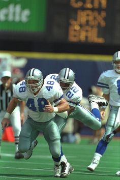 Daryl Johnston paves the way for Emmitt Smith
