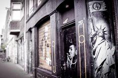 Street Art Amsterdam - Statue of liberty holding a peace flag #Graffiti #Stencil Art
