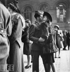 """Penn Station, 1943 - WWII soldier says goodbye to his wife before shipping out."""