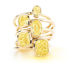 Tiffany Bezet follows the contours of oval and cushion modified  brilliant yellow diamonds, accentuating their shapes in streamlined 18k gold  bezel settings. Elegant, modern and simply radiant.