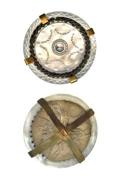 18th Century Mother of Pearl Pad Back Button. Found at http://www.buttoncountry.com. Mother of pearl, metal and fabric. (The four-pronged brass spider shank enables these types of buttons to be displayed).