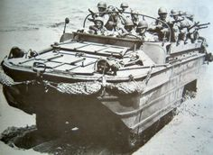 US Army DUKW landing on a beach with troops, date unknown; note M1 Garand rifles