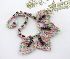 Hand crocheted with multicolored Anchor Pearl Cotton thread and finished with Swarovski beads this set is light and comfortable to wear.