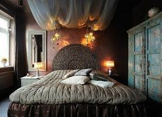 Bohemian bedroom ♥ the dark walls, pretty overhead lights and hanging fabric. zzzz....