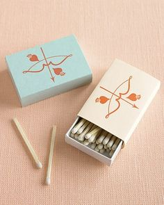 For the matchboxes, print the Cupid's-bow art on text-weight paper, trim to size, and wrap around boxes (without covering the striking surface).