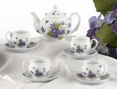 $31.99 Purple Bouquet Tea Set for Children Includes a beautiful Purple Bouquet decorated tea pot, tea cups, saucers, creamer, and sugar. Comes in a pretty pink and white box, lined with taffeta. This item is porcelain and may break with rough play. For ages 5 and up.