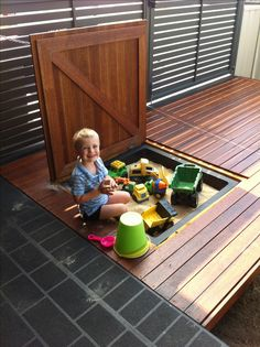 Sand pit disguised in deck.