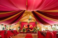 Gorgeous fabric draping for a wedding, wedding decor,  Swags www.tablescapesbydesign.com