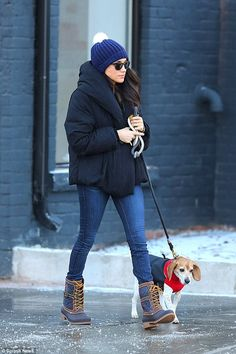 Prince Harry's girlfriend was seen wrapped up warm as she braved the icy conditions of the...