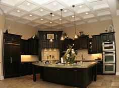 Love this kitchen...the ceiling, cabinetry, tile...except, wouldn't the microwave be too high for the average person?