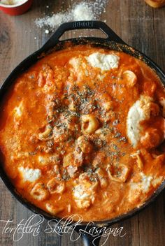 A simple skillet lasagna with Italian turkey sausage and tortellini! www.lemonforlulu.com
