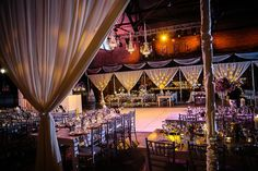 WOW! This venue was completely transformed from a rock and roll concert venue to a vintage inspired wedding reception! #wedding #vintagetheme #reception #eventdesign