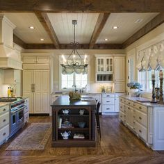 painted black beams with white tongue and groove | The kitchen features a painted tongue and groove ceiling with beam ...