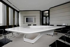 Futuristic Conference table design by KINZO for Ernst & Young