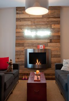 Cozy up to this fantastic fireplace - love the juxtaposition of the stainless steel and reclaimed wood.