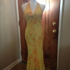 Scala yellow with peach accents dress  Beautiful dress worn once for a wedding. Yellow dress with peachy accents. Shimmers all over with open back. Shell: 100% silk  Lining:100% polyester. Very flattering dress Scala Dresses