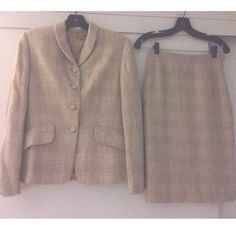 """🌼HP🌼 VTG BURBERRYS' SILK & CASHMERE TWEED SUIT Stunning, classic skirt suit from Burberrys'. Signature plaid design - very subtle in a tweed finish. Covered button front closure, single breasted, fully, lined. Blazer has two front flap pockets, skirt has a flat front and side closure - zip and button, back center vent. Blazer: 23.25"""" long, sleeves are 23"""" long, 19"""" pit to pit, 16"""" shoulder to shoulder Skirt: 13.5"""" across waist, 19.5"""" across hip, 23.75"""" long Dry clean only Made in Italy…"""