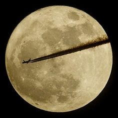 "An aircraft flies past the moon over Somerset, as it is at its closest point to the Earth for almost two decades. 3/21/2011, ""The Telegraph"""