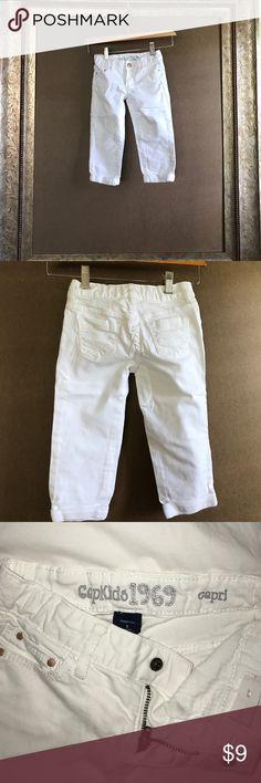 White denim cuffed capris. GapKids1969 white denim cuffed capris. 3 front pockets 2 back pockets. Zip and snap fly with adjustable waist. GAP Bottoms Jeans
