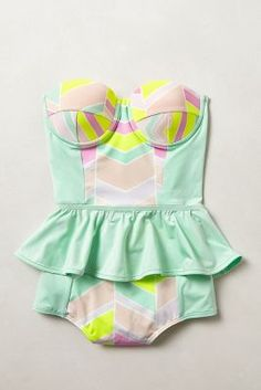 Peplum ruffled waist one-piece swimsuit with padded underwire cups.