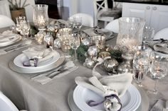 A beautiful table set for winter entertaining in shades of greys, silver, and purples.