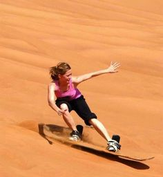 Surfing the Sahara! ~ We used to sand surf dunes here in Florida but it was nothing like this.