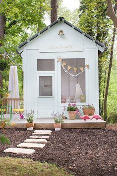This outdoor children's playhouse is like a beach cottage.